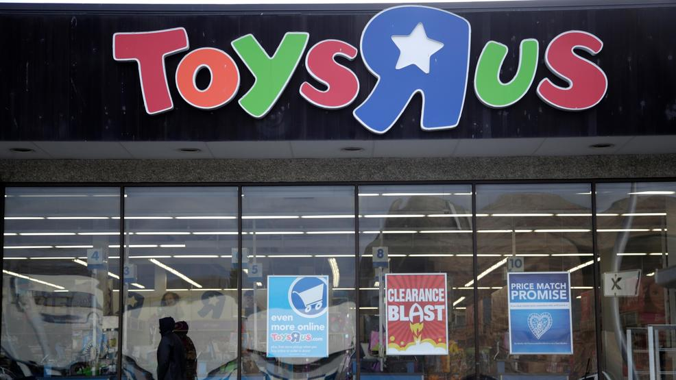 File- This Jan. 24, 2018, file photo shows a person walking near the  entrance to a Toys R Us store, in Wayne, N.J. Toys R Us's management has  told its ...