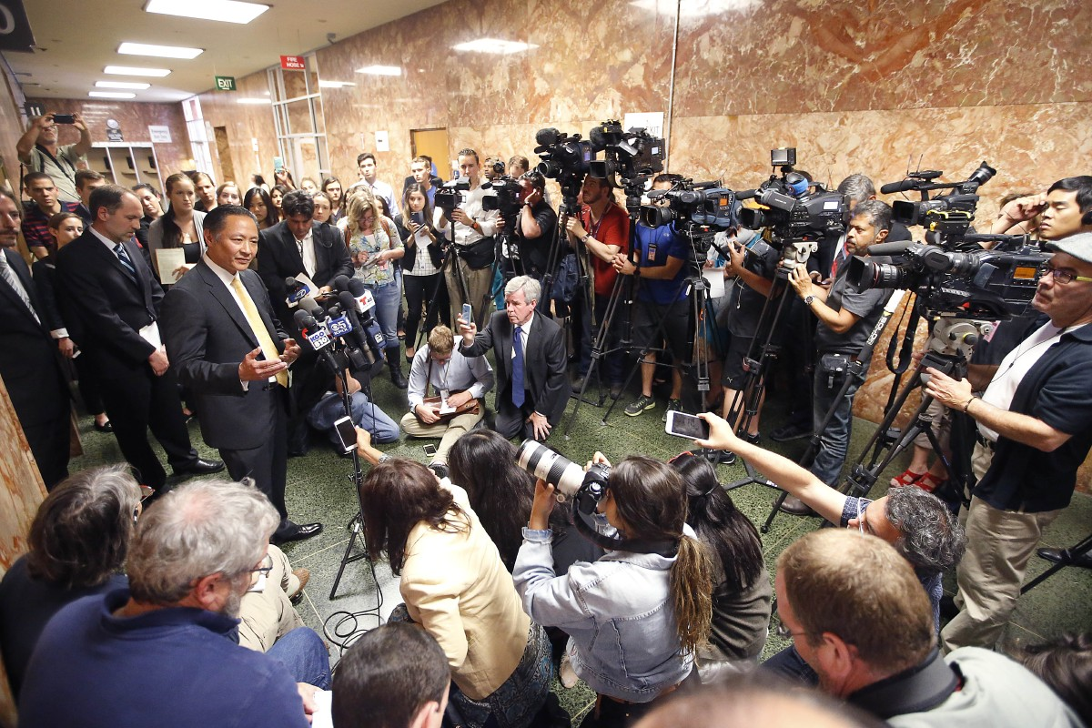 San Francisco Public Defender Jeff Adachi, left, talks to members of the media after Francisco Sanchez' arraignment Tuesday, July 7, 2015, in San Francisco. Prosecutors have charged Sanchez, a Mexican immigrant, with murder in the waterfront shooting death of 32-year-old Kathryn Steinle. (AP Photo/Tony Avelar)