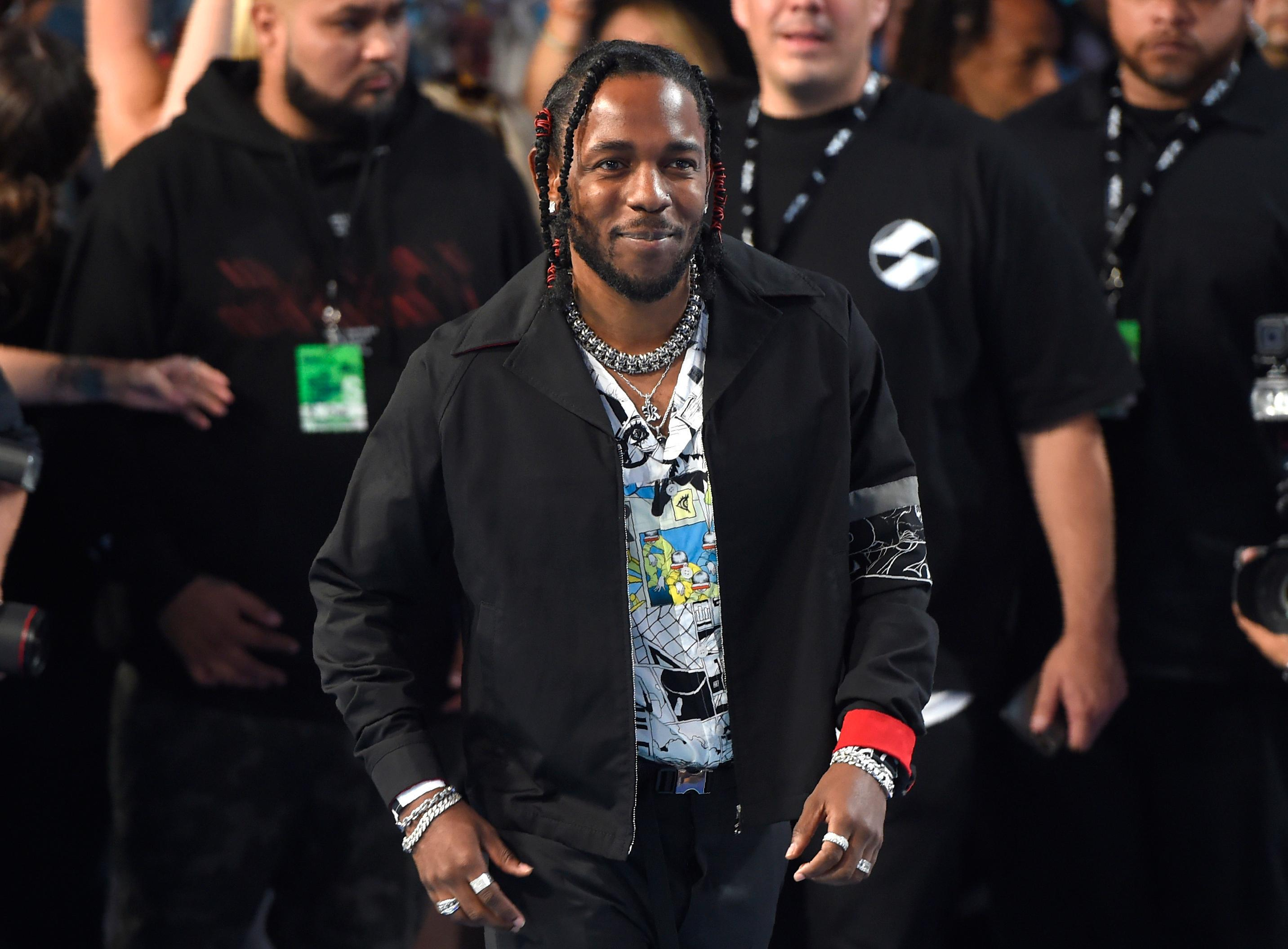 FILE - In this Aug. 27, 2017 file photo, Kendrick Lamar arrives at the MTV Video Music Awards at The Forum  in Inglewood, Calif.  Lamar and Olympic gymnast Aly Raisman are among the celebrities, athletes and business leaders heading to Boston for Forbes' Under 30 Summit. The four-day event focused on technology and business starts Sunday, Oct. 1 and runs through Wednesday. (Photo by Chris Pizzello/Invision/AP, File)