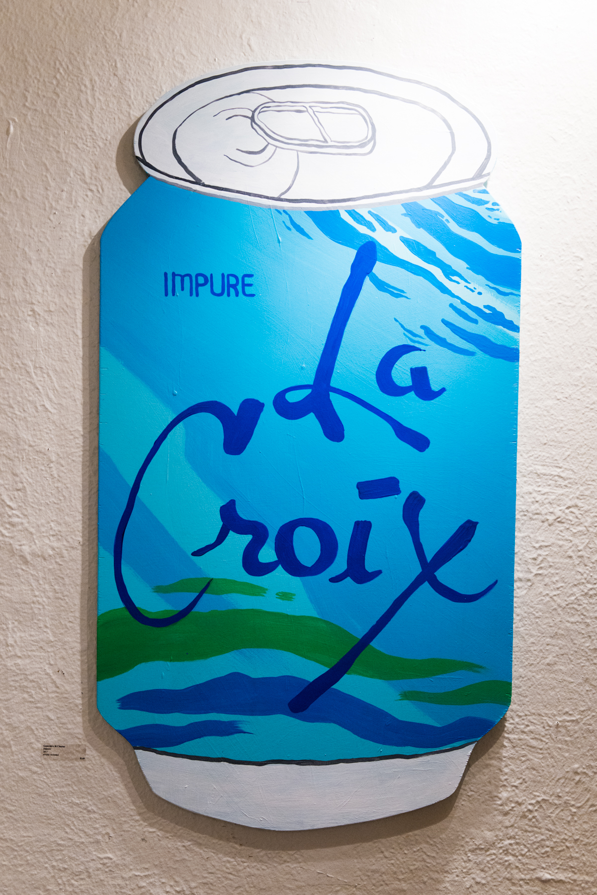 How about a long cold sip of Tinder Man Holding Fish? Fancy the flavor of a Werewolf Bar Mitzvah? Or perhaps a taste of a Post Bowie World? Seattle artist Genevieve St. Charles Monet reimagined the beloved brand La Croix as part of Capitol Hill Art Walk last night, December 14 2017. Food Art Collective, the space that hosted the show is a (you guessed it) food-centric art gallery that fully embraces the culture around food and everything that comes with it. Life imitates art, right? Crack open a cold one and click through prismatic photos of the show ahead. (Image: Chona Kasinger / Seattle Refined)