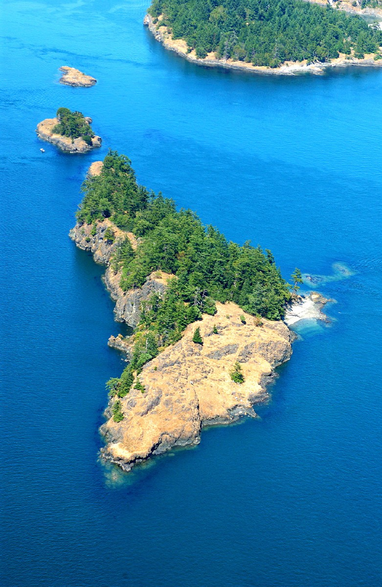 Ram Island is located about 9 miles east of Anacortes Washington on Lopez Pass between Lopez and Decatur Islands, and is 8.8 acres according to the San Juan County Assessor. It's for sale with Kent Meeker Inc. for $3.5 million.(Image: Robert Demar)