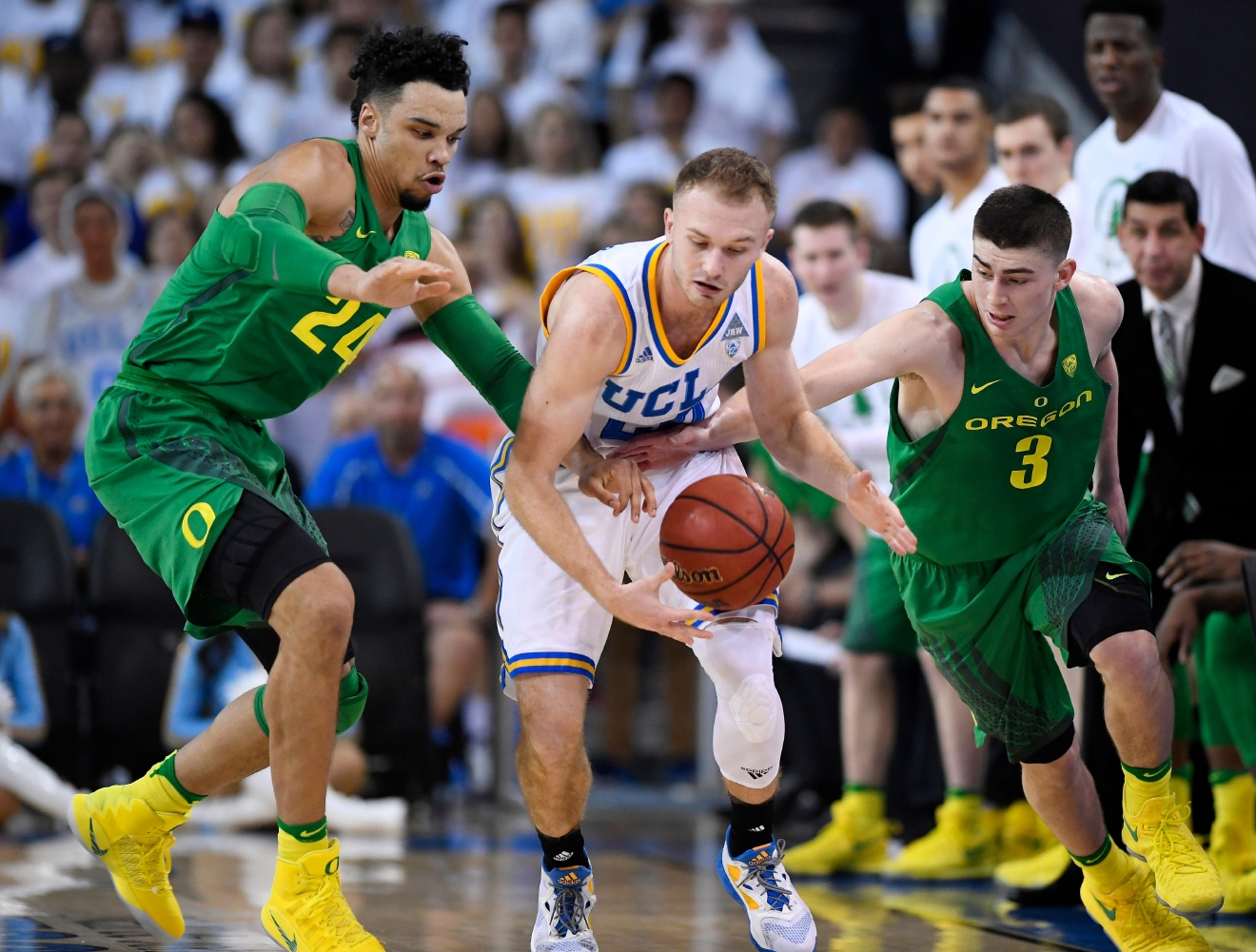 UCLA guard Bryce Alford, center, reaches for a loose ball along with Oregon forward Dillon Brooks, left, and guard Payton Pritchard during the first half of an NCAA college basketball game, Thursday, Feb. 9, 2017, in Los Angeles. (AP Photo/Mark J. Terrill)