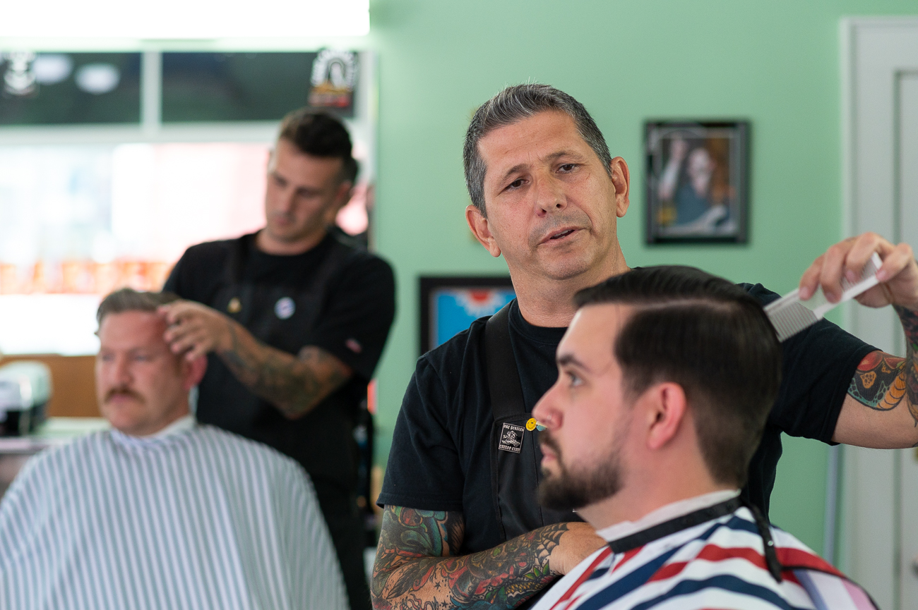 "Chris is a former pipefitter who quit his job to follow his passion for going to barbering school and starting a shop of his own. ""My only complaint is I wish I'd done it sooner. I have more friends than ever,"" he says. / Image: Phil Armstrong, Cincinnati Refined // Published: 7.10.20"
