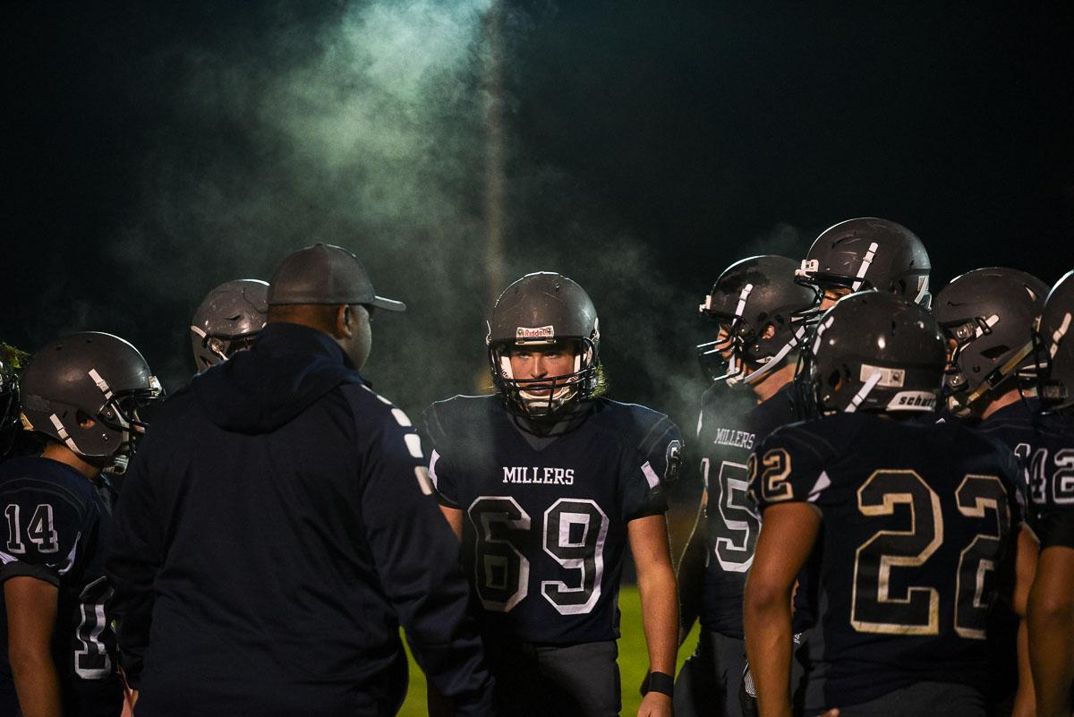 Springfield defensive players listen to their coach during a chilly night at Springfield High School.  The Millers would lose to undefeated Churchill 56-7 who remain 7-0 on the season. Photo by Jeff Dean, Oregon News Lab