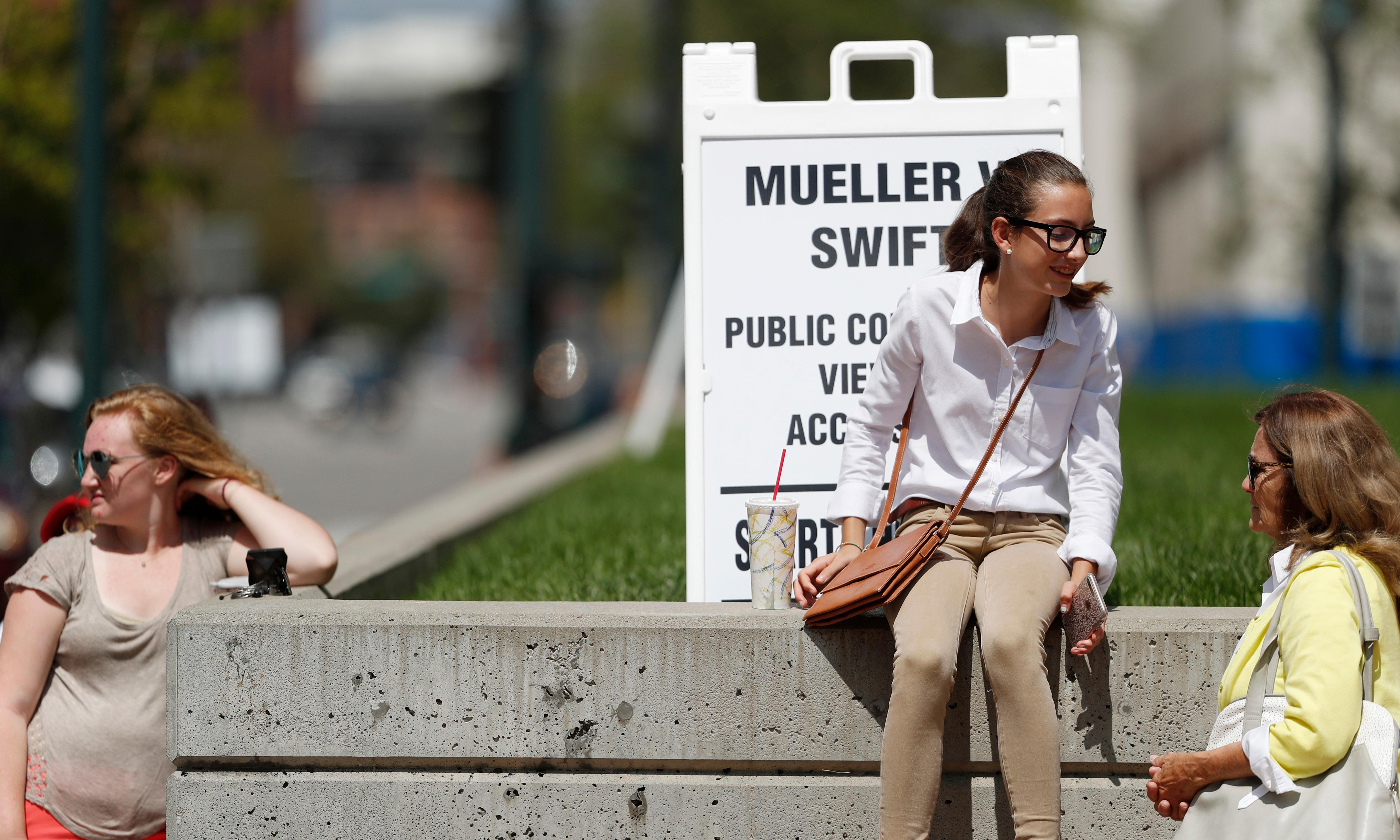 Fourteen-year-old Kennedy Wares, second from right, confers with her grandmother, Nancy Elliott, both of Littleton, Colo., as they move up the public line to view the civil trial involving pop singer Taylor Swift, Friday, Aug. 11, 2017, in Denver. (AP Photo/David Zalubowski)