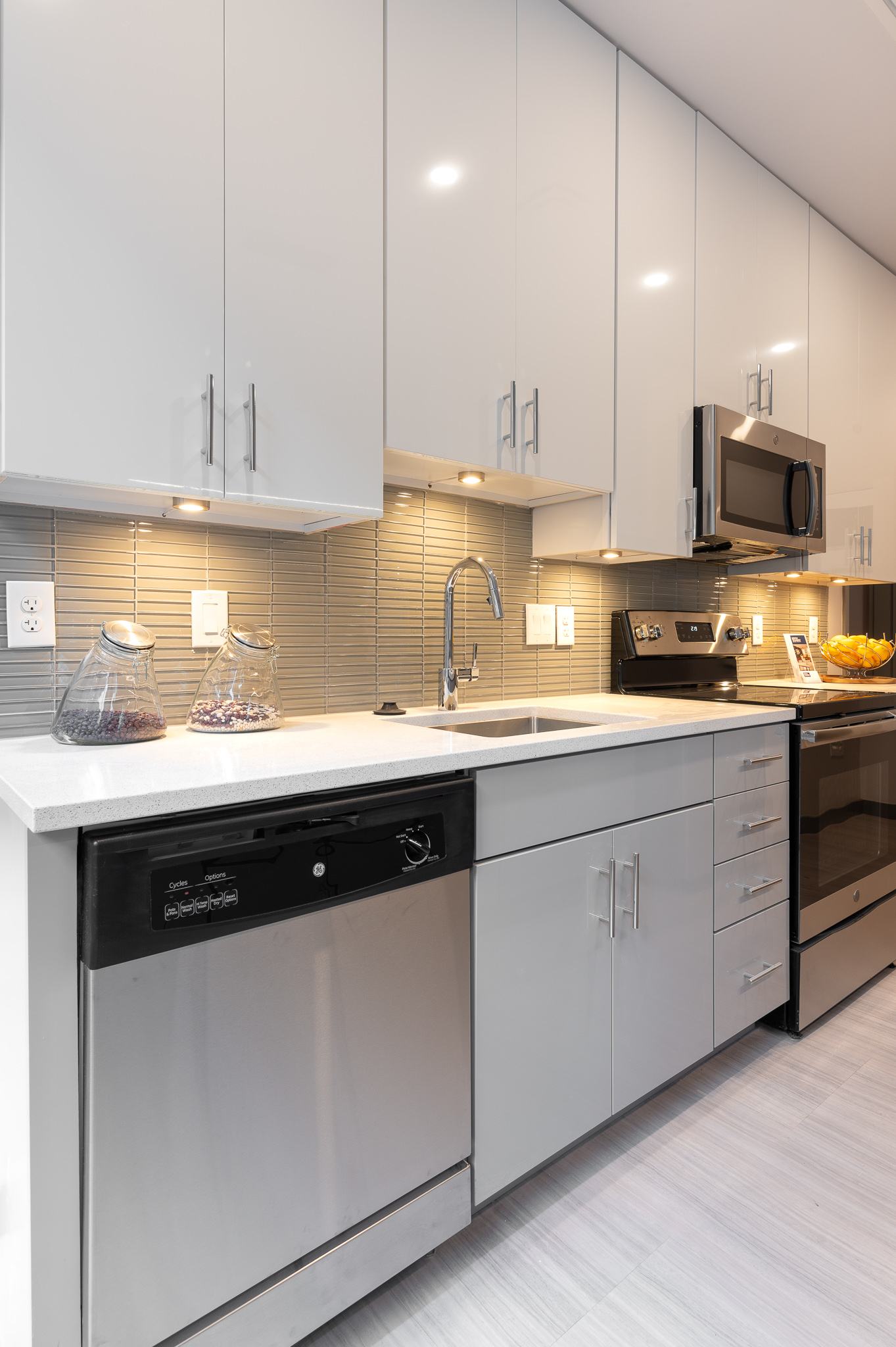 <p>Most apartments have sizable kitchens that are outfitted with GE appliances. / Image: Phil Armstrong, Cincinnati Refined // Published: 12.25.19</p>