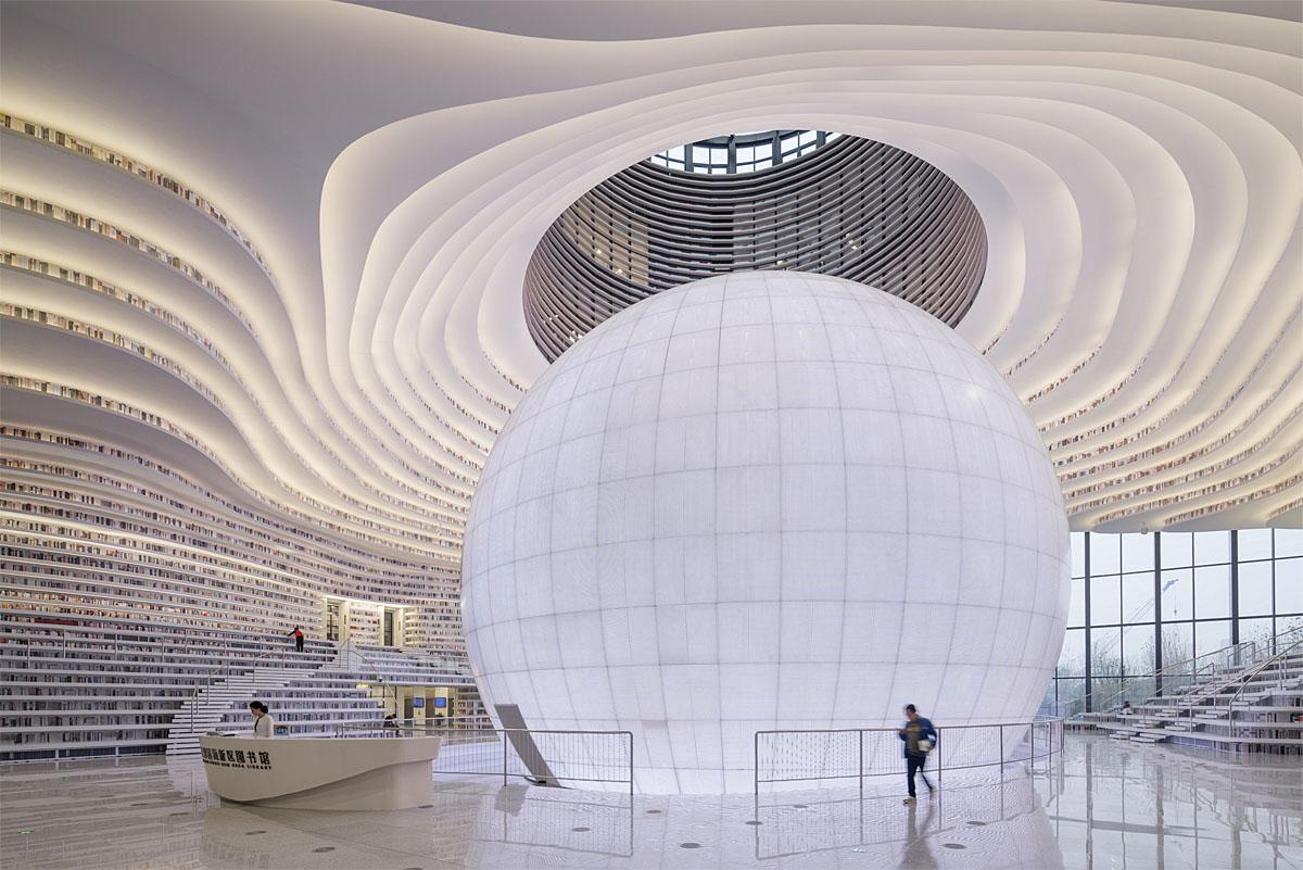 Nobody likes to be watched while they're trying to read a book, but we're willing to make an exception if it means getting to visit this stunning new library in China, because the incredible structure has a giant spherical auditorium in the middle that looks just like a giant eye. (Credit: Ossip van Duivenbode/Cover Images)