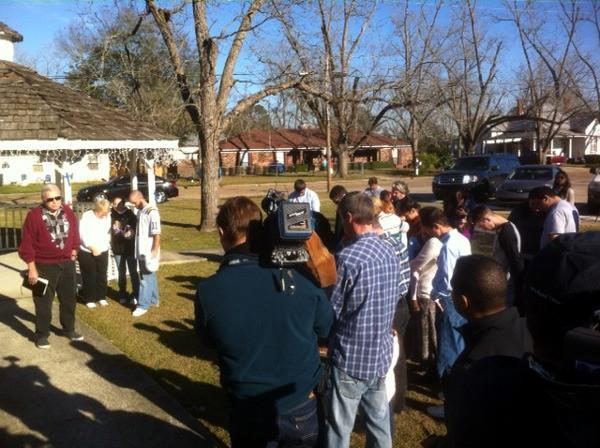 Local residents in Midland City, Ala. hold a prayer vigil on Saturday, February 2, 2013.