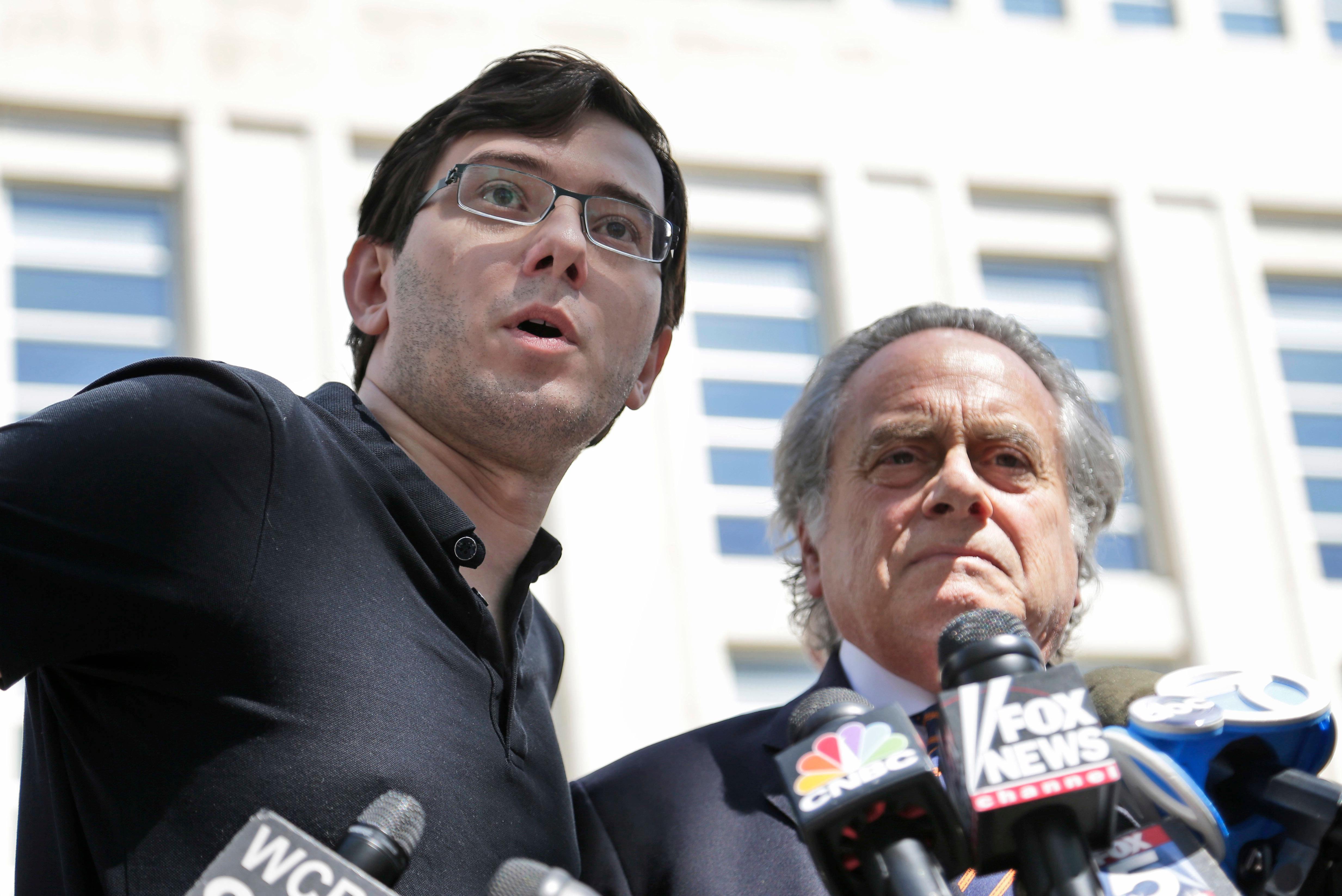 Martin Shkreli, left, talks with reporters while standing next to his attorney Benjamin Brafman after leaving federal court in New York, Friday, Aug. 4, 2017. The former pharmaceutical CEO has been convicted on federal charges he deceived investors in a pair of failed hedge funds. A Brooklyn jury deliberated five days before finding Shkreli guilty on Friday on three of eight counts. (AP Photo/Seth Wenig)