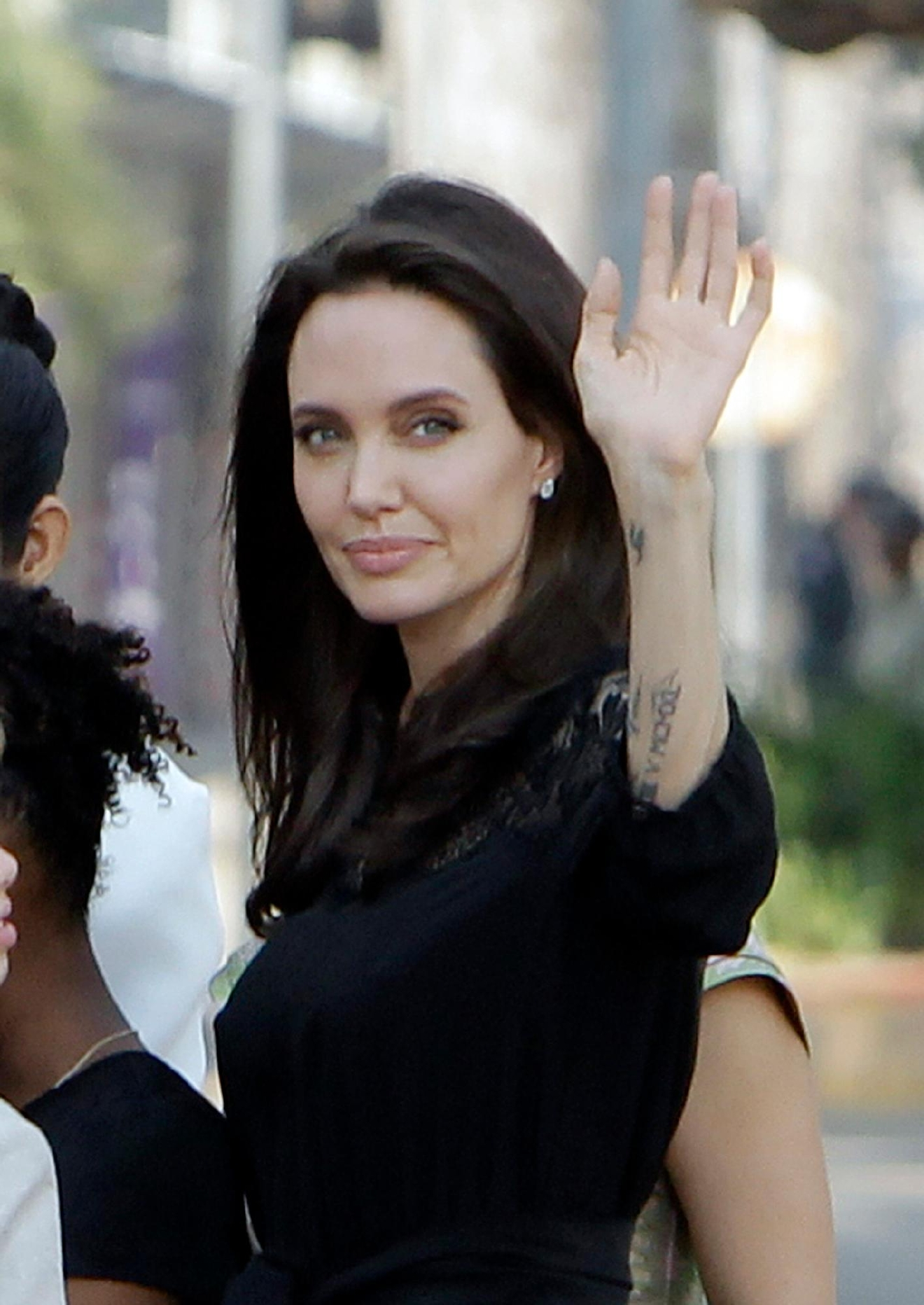 "Hollywood actress Angelina Jolie waves to visitors while she waits to meet Cambodia's King Norodom Sihamoni in Siem Reap, Cambodia, Saturday, Feb. 18, 2017. Jolie on Saturday launches her two-day film screening of ""First They Killed My Father"" in the Angkor complex in Siem Reap province. (AP Photo/Heng Sinith)"