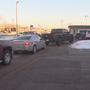 Warm weather brings long lines for car washes