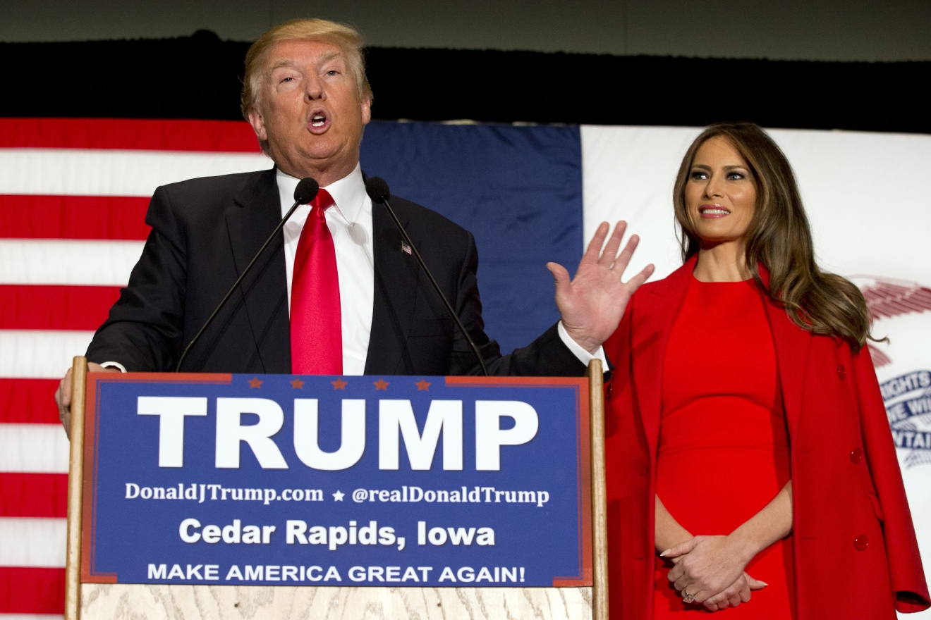 FILE - In this Feb. 1, 2016 file photo, Republican presidential candidate Donald Trump, accompanied by his wife Melania Trump, speaks during a campaign event in Cedar Rapids, Iowa. Ted Cruz accused Trump of stoking false rumors about his personal life on Friday, March 25, 2016, charging that the billionaire businessman and GOP front-runner is trafficking in Â?sleazeÂ? and Â?slime.Â? (AP Photo/Mary Altaffer, File)