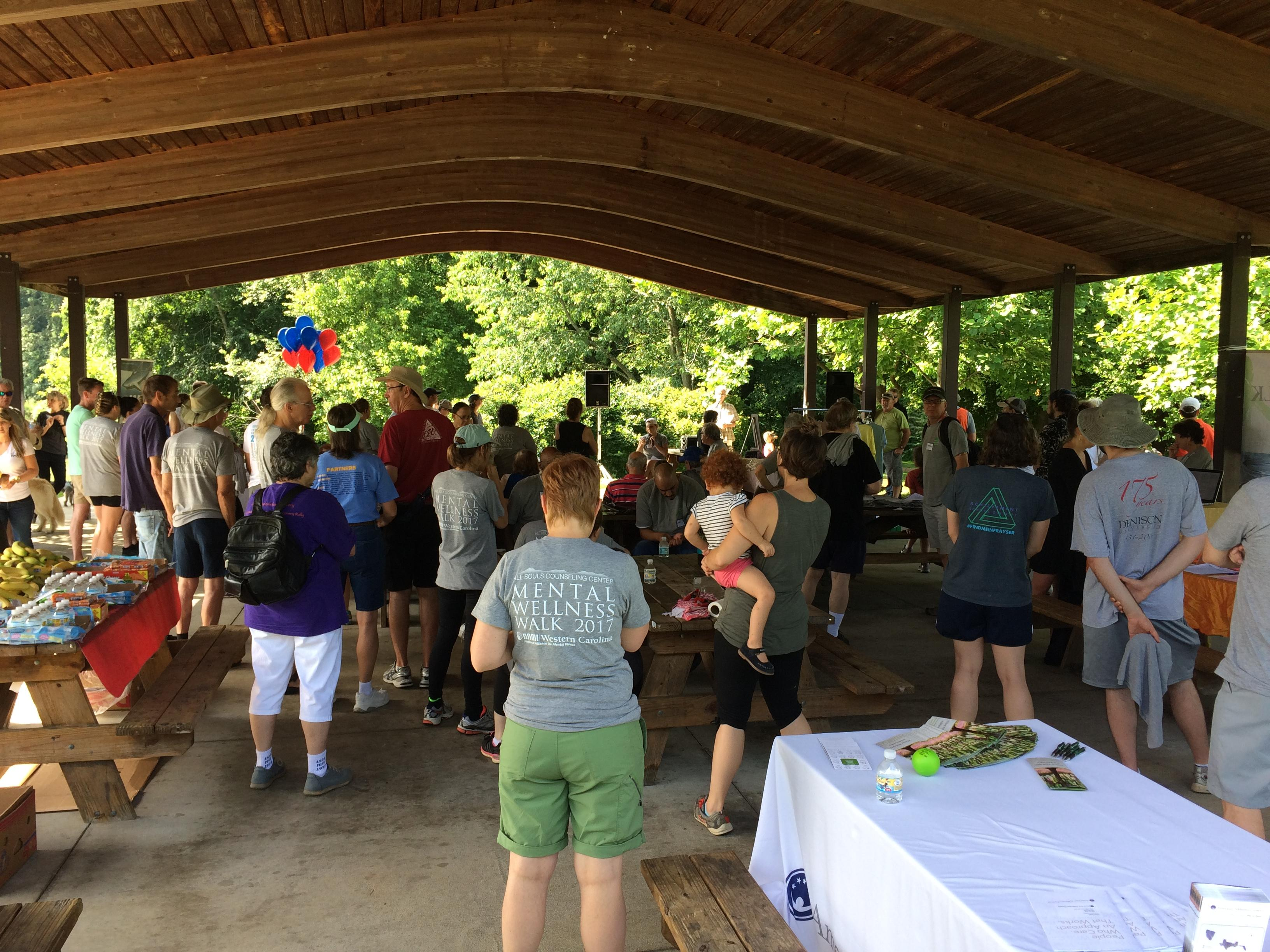 Over one hundred people gathered at Carrier Park Saturday morning to raise awareness for mental health. (Photo credit: WLOS Staff)