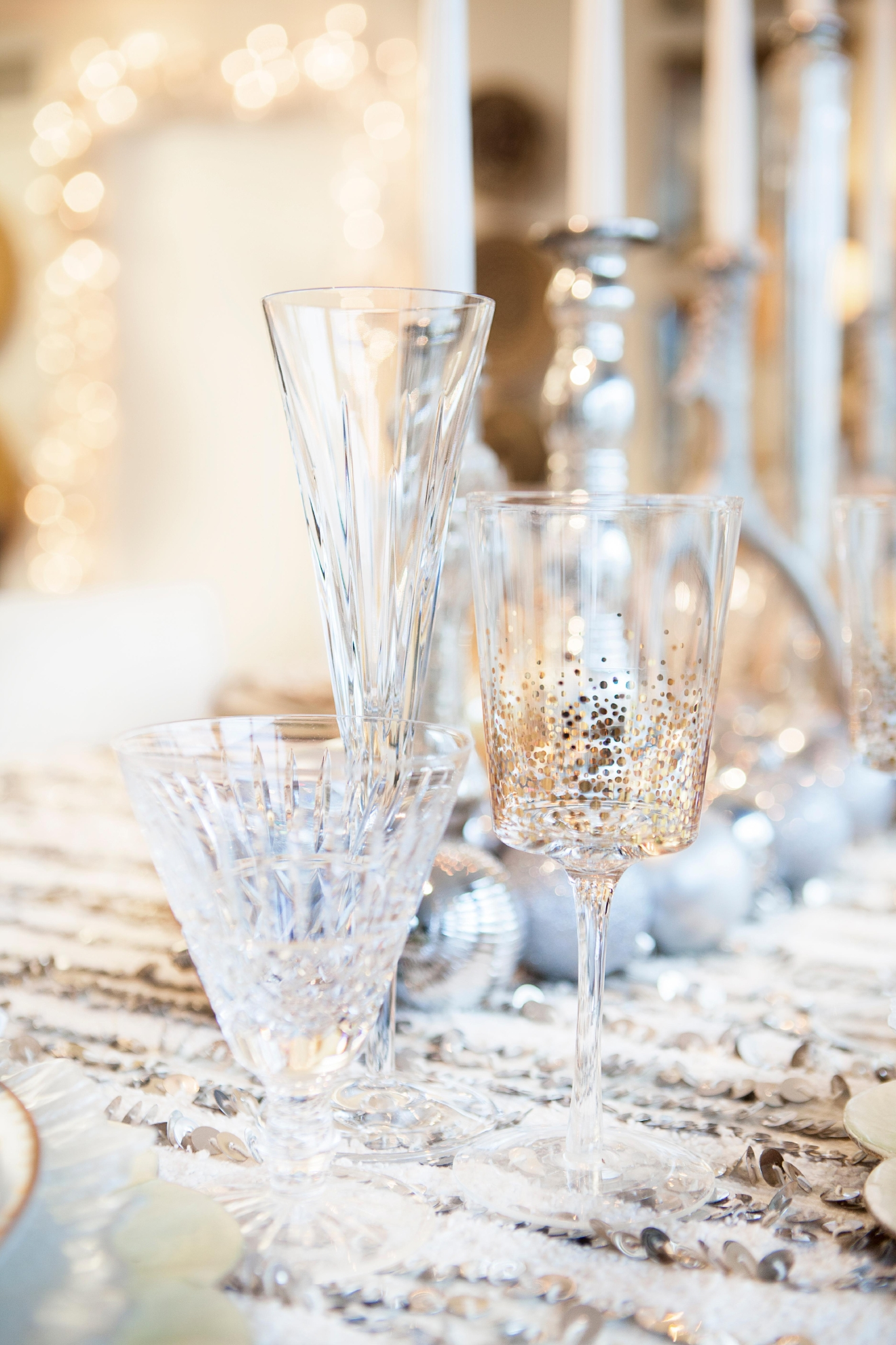 "There is no reason you have to be ""matchy matchy"" so mix patterns! Your guests will love this playful element. Try mixing different glasses together and giving the head of the table an extra special touch with different salad plates and champagne flutes than the rest of the guests. (Image: Ashley Hafstead)"