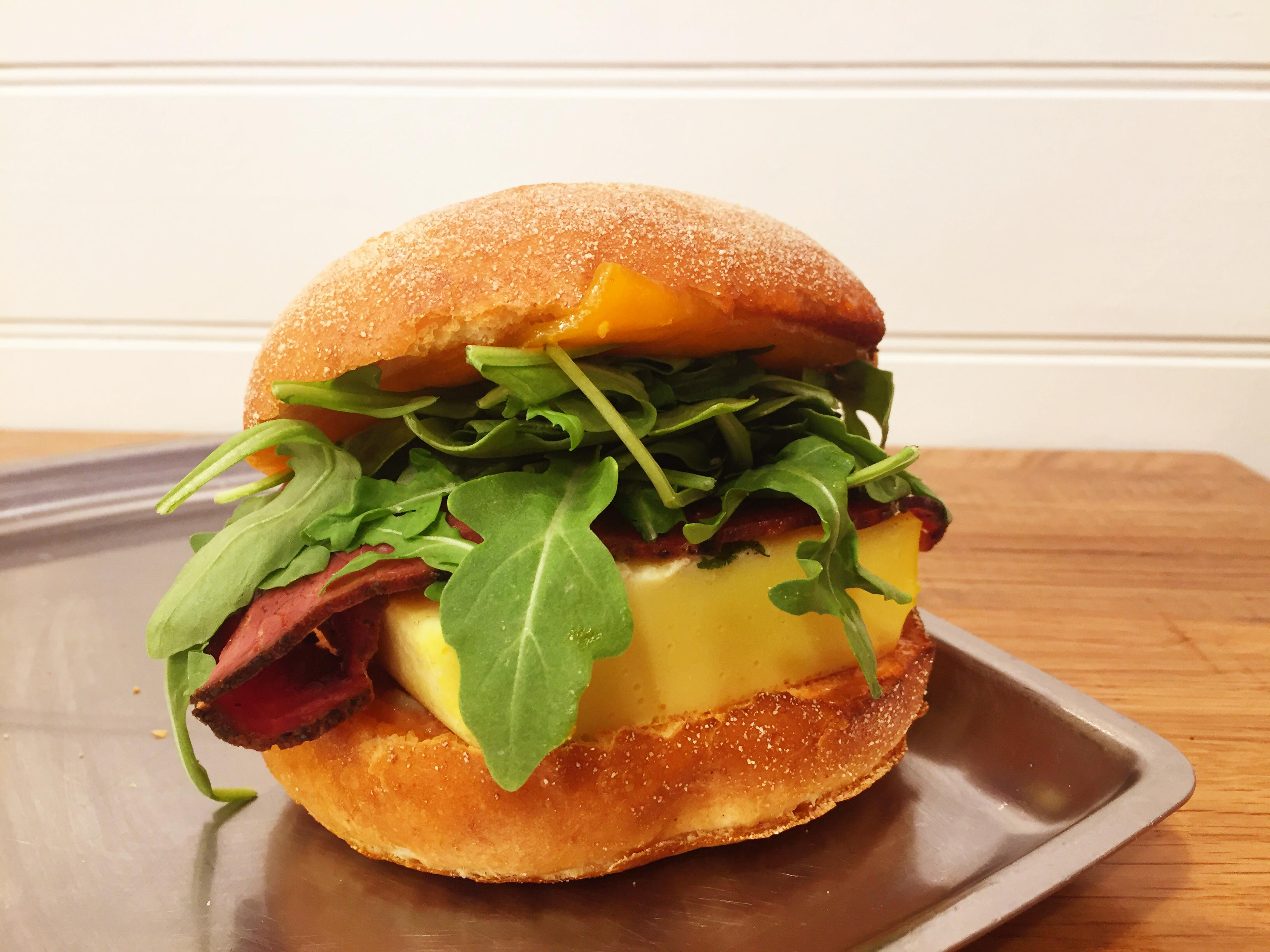 "This modern iteration of a Jewish deli just launched an all-day breakfast menu, featuring an egg and cheese sandwich: omelet, cheddar, arugula, and Russian dressing on a toasted challah Kaiser roll ($5.99). Add avocado or pastrami ""bacon"" if you're feeling adventurous. (Image: Courtesy On Rye)"