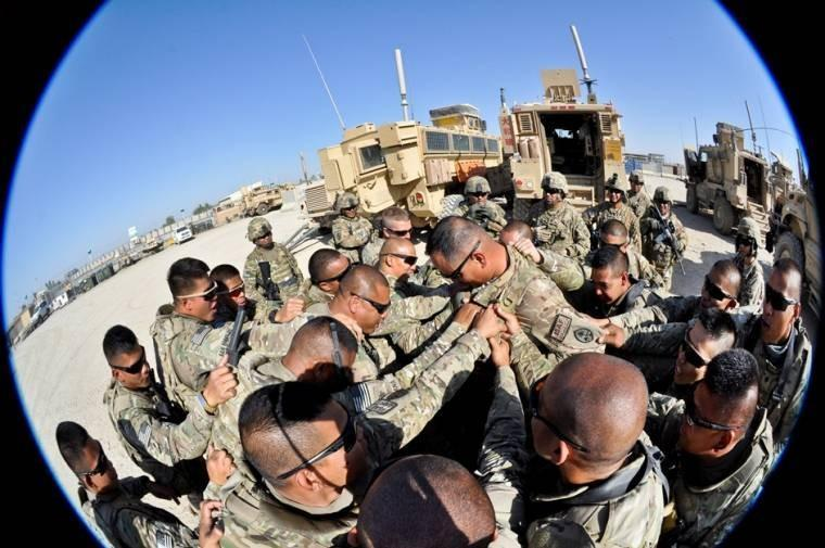 U.S. Army 1st Sgt. John C. Pangelinan, center, receives a pre-mission battle cry from his soldiers on Main Operating Base Lashkar Gah in Afghanistan's Helmand province in late September, 2013.