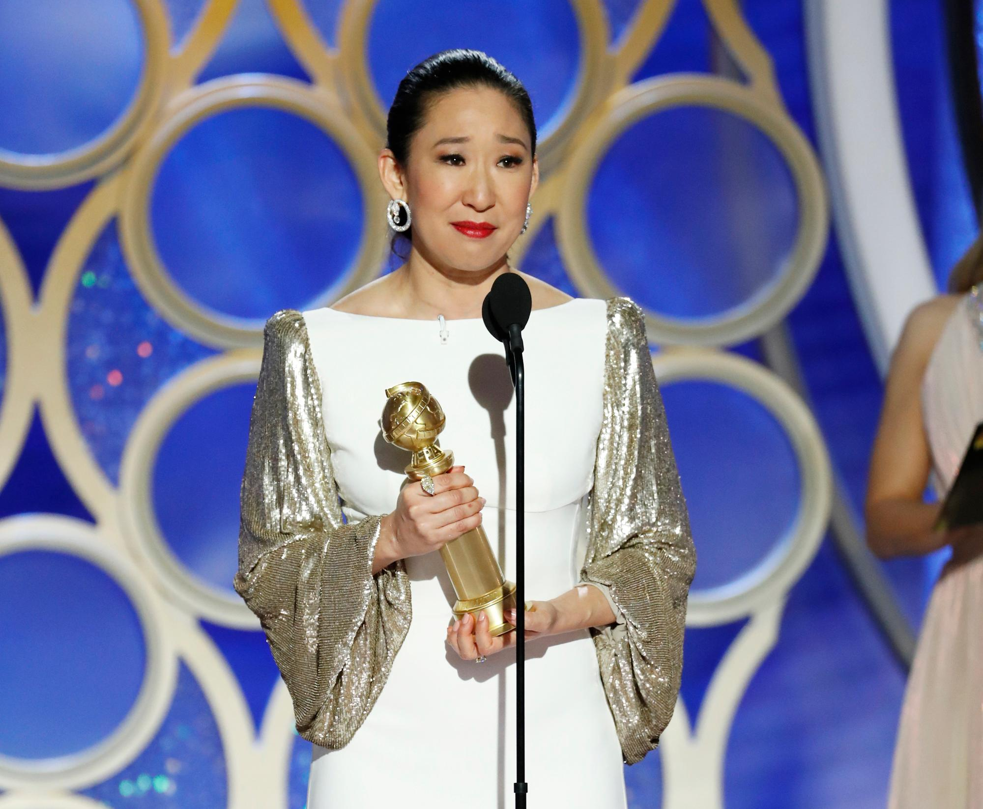 "This image released by NBC shows Sandra Oh accepting the award for best actress in a drama series for her role in ""Killing Eve"" during the 76th Annual Golden Globe Awards at the Beverly Hilton Hotel on Sunday, Jan. 6, 2019 in Beverly Hills, Calif. (Paul Drinkwater/NBC via AP)"