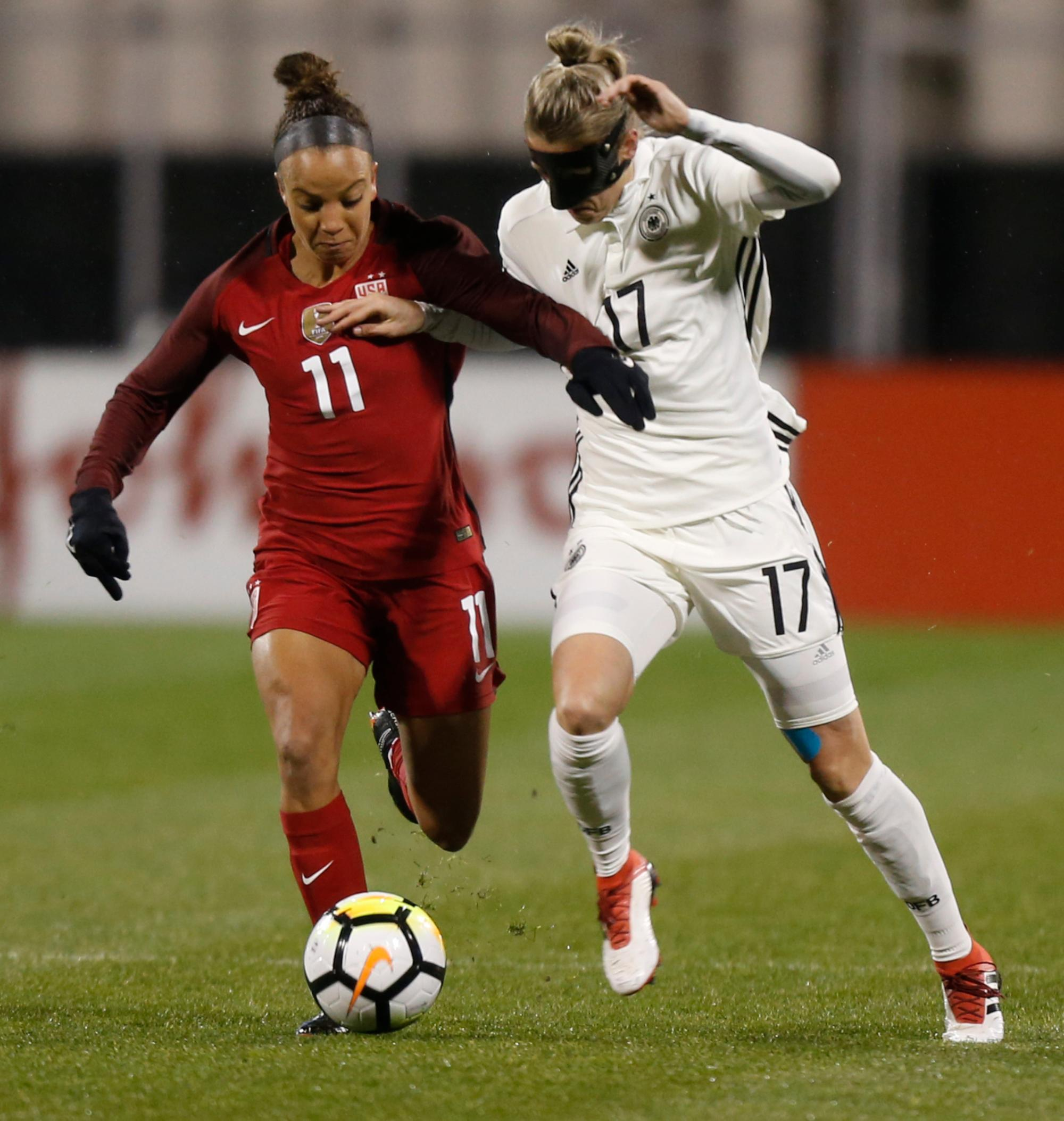 United States' Mallory Pugh, left, and Germany's Verena Faisst race for the ball during the first half of a SheBelieves Cup women's soccer match Thursday, March 1, 2018, in Columbus, Ohio. (AP Photo/Jay LaPrete)