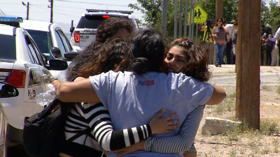 Parents embraced their children once they were reunited after Austin High School was placed on lockdown Thursday, May 18, 2017. (Credit: KFOX14/CBS4)