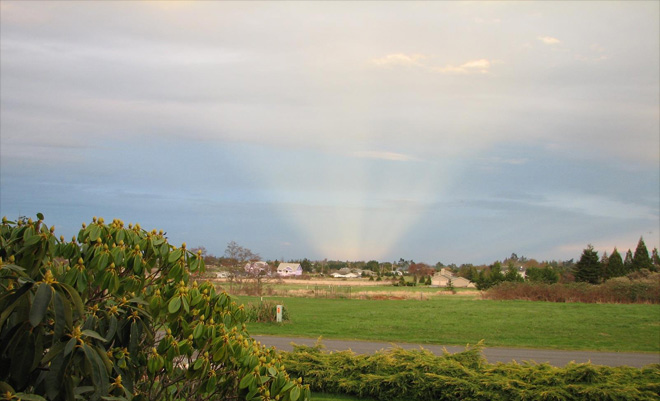 Anti-crepuscular rays seen over Sequim, Wash. on Feb. 26, 2013. (Photo: Judy Davidson)