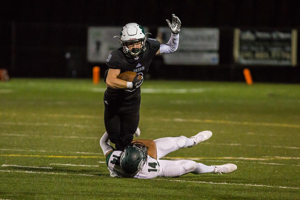 Sheldon wide receiver Jack Folsom (#9) gets tripped up by West Salem defensive back Noor Dhote (#14). On a rainy Monday evening Sheldon defeated West Salem 41-7 at home. The game had been postponed from Friday due to unhealthy levels of smoke in the atmosphere due to nearby forest fires. Photo by Dillon Vibes