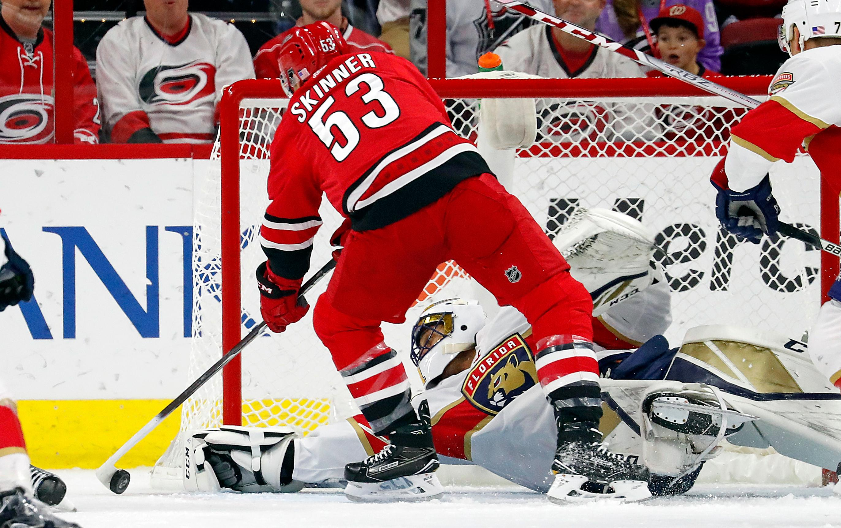 Carolina Hurricanes' Jeff Skinner (53) tries to stuff the puck past Florida Panthers goalie Roberto Luongo (1) during the first period of an NHL hockey game, Tuesday, Nov. 7, 2017, in Raleigh, N.C. (AP Photo/Karl B DeBlaker)