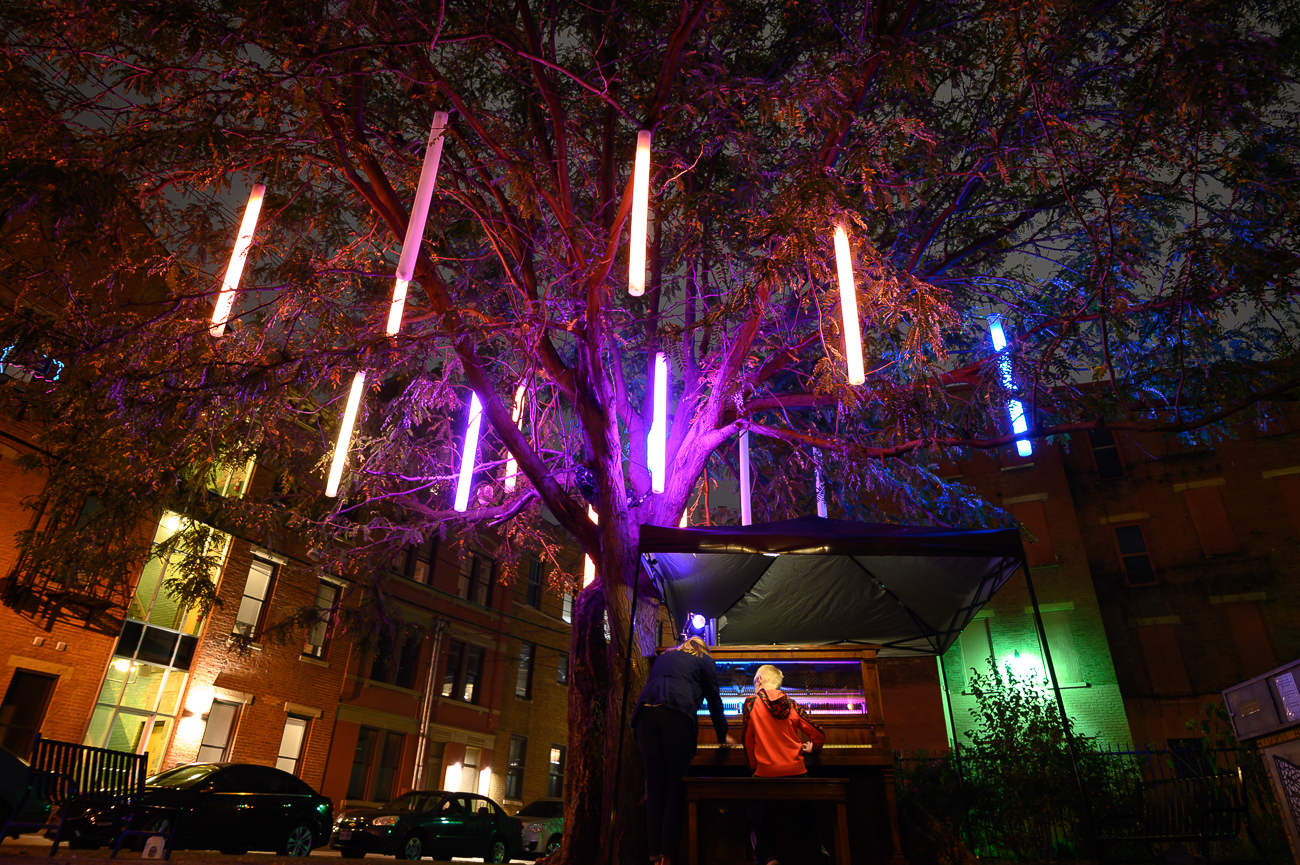 PICTURED NEIGHBORHOOD: Over-the-Rhine / This one is a must-see! A piano at the corner of Republic and 13th Streets lights up hanging color-changing lights suspended from the tree above it. Anyone is allowed to come up and play the piano. / Image: Phil Armstrong // Published: 10.12.19