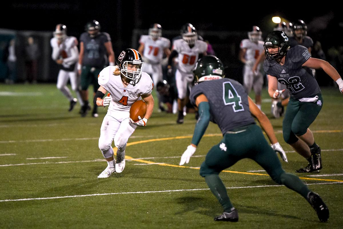 Beaverton wide receiver Grant Kirby (#4) racks up major yardage during Beaverton's 48-7 loss to Sheldon in the first round of the state high school playoffs.  Photo by Jeff Dean Oregon News Lab