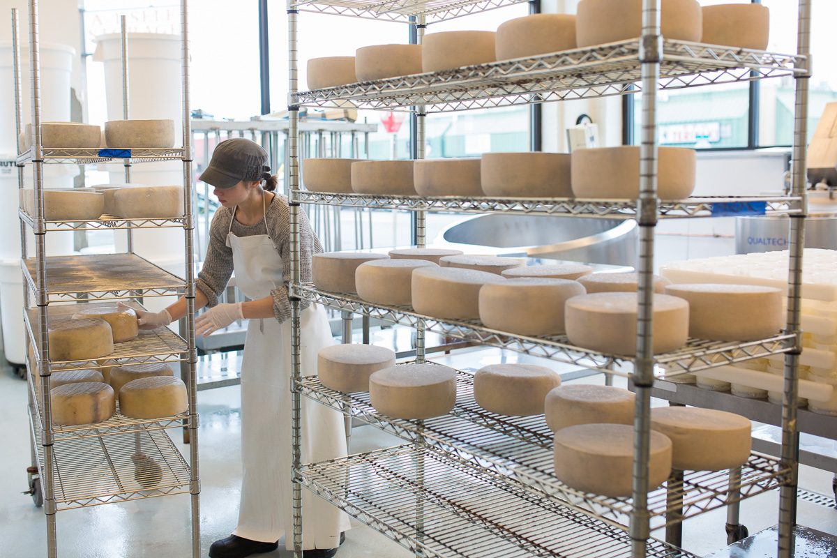 Stop by Ancient Heritage Dairy, the only urban creamery in Portland, and peek through the huge windows to see the gorgeous cheeses being made. (Image: Paola Thomas / Seattle Refined)