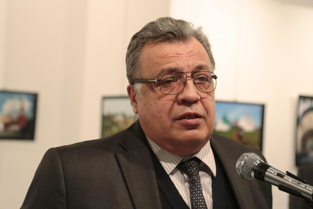 The Russian Ambassador to Turkey Andrei Karlov speaks a gallery in Ankara Monday Dec. 19, 2016. A gunman opened fire on Russia's ambassador to Turkey Karlov at a photo exhibition on Monday. The Russian foreign ministry spokeswoman said he was hospitalized with a gunshot wound. (AP Photo/Burhan Ozbilici)