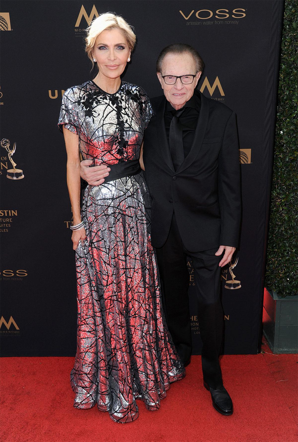 Larry King, right, and Shawn King arrive at the 43rd annual Daytime Emmy Awards at the Westin Bonaventure Hotel on Sunday, May 1, 2016, in Los Angeles. (Photo by Richard Shotwell/Invision/AP)