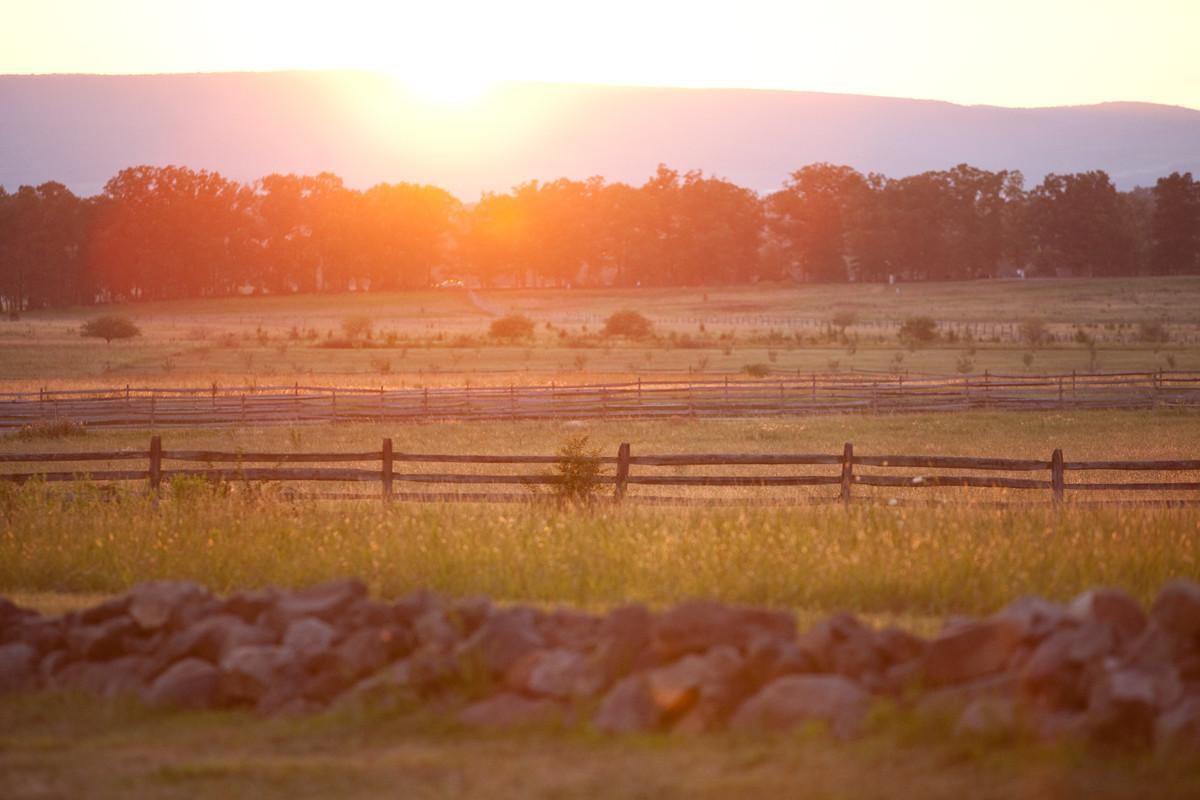 <p>Sunset over Pickett's Charge at Gettysburg National Military Park. (Photo courtesy of Destination Gettysburg/Jeremy Hess)</p>