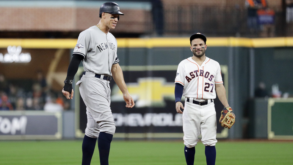 New York Yankees' Aaron Judge, left, talks with Houston Astros second baseman Jose Altuve during the third inning in Game 6 of baseball's American League Championship Series Saturday, Oct. 19, 2019, in Houston.
