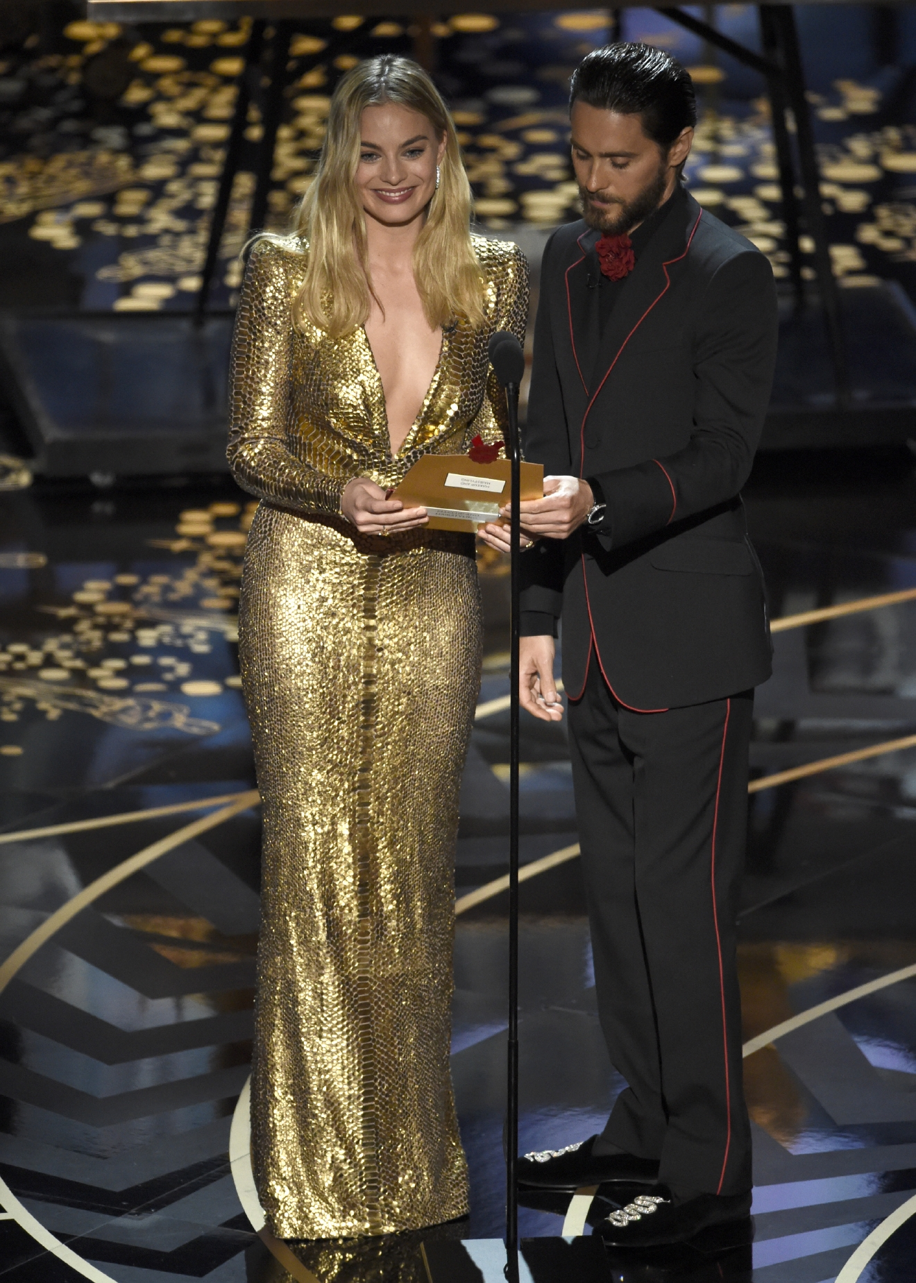 Margot Robbie, left, and Jared Leto present the award for best makeup and hairstyling at the Oscars on Sunday, Feb. 28, 2016, at the Dolby Theatre in Los Angeles. (Photo by Chris Pizzello/Invision/AP)