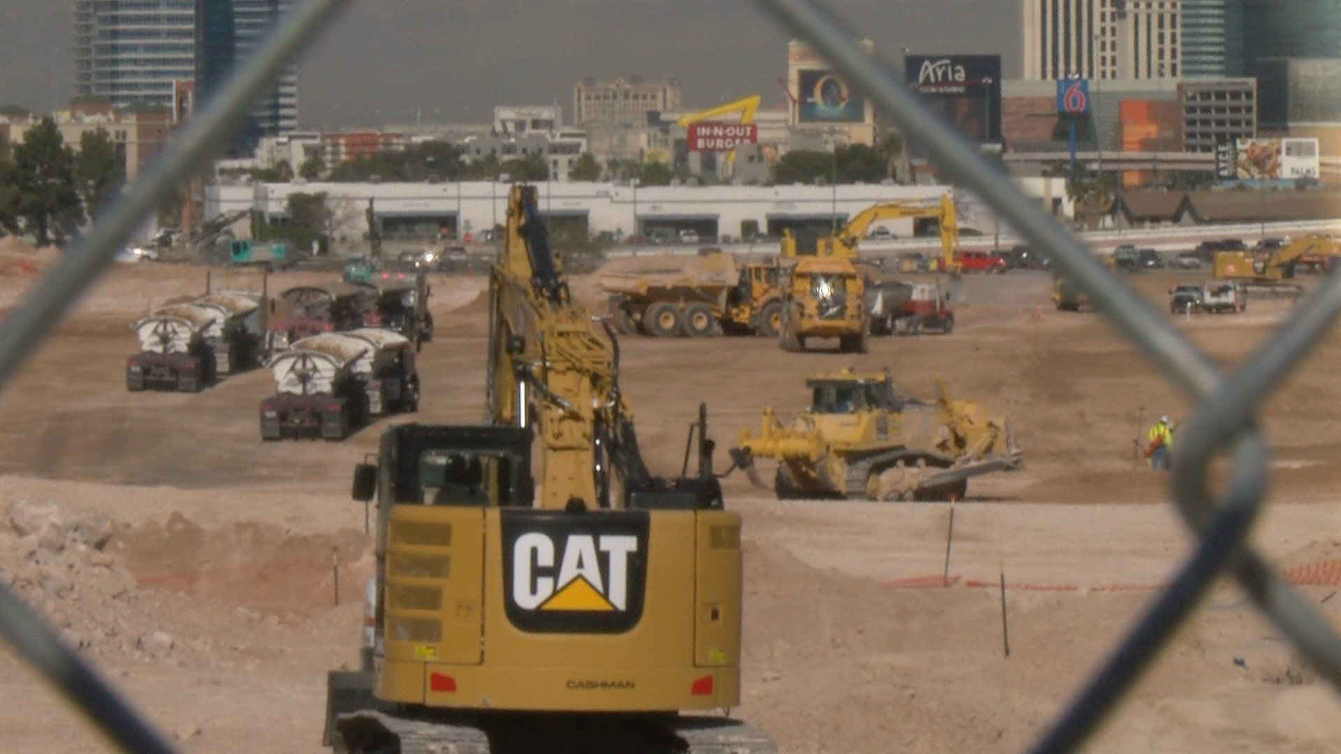 Suddenly, Las Vegas' most-watched 68 acres, bordered by I-15 and Russell, is a virtual beehive of activity as crews begin construction of the new Raiders stadium. (KSNV)