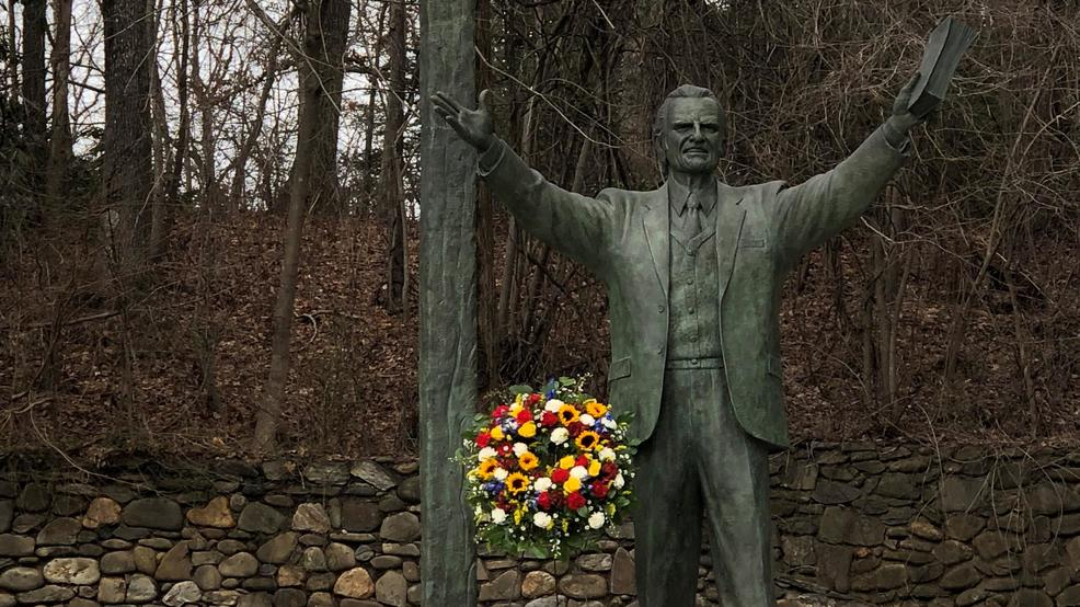 Flowers placed at Graham statue at Ridgecrest