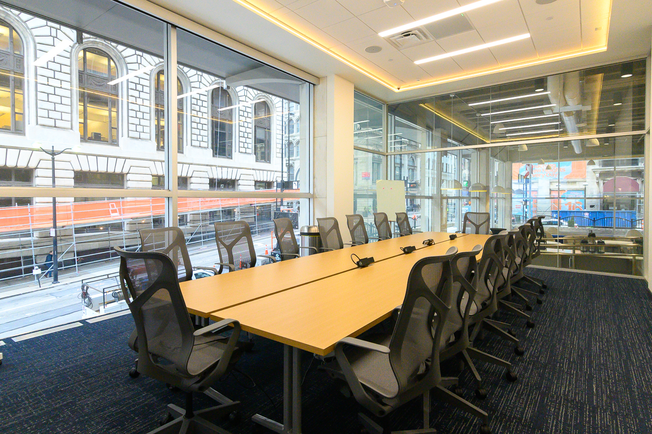 The large conference room can be reserved by anyone. Inside, adjustable privacy glass can be enabled with the tap of a screen on the wall to separate your meeting from the rest of the space. It's fully equipped with a screen to accommodate slide shows and video presentations as well. Accent lights around the top of the room can be changed to fit the theme of the meeting (example: your business's colors), and a Samsung smart blackboard is available to use. / Image: Phil Armstrong, Cincinnati Refined // Published: 2.25.20