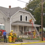 Flames break out in Woonsocket home
