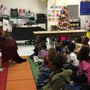 Volunteers read to Dublin students to promote literacy