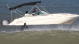 Surfer says boater nearly ran him over