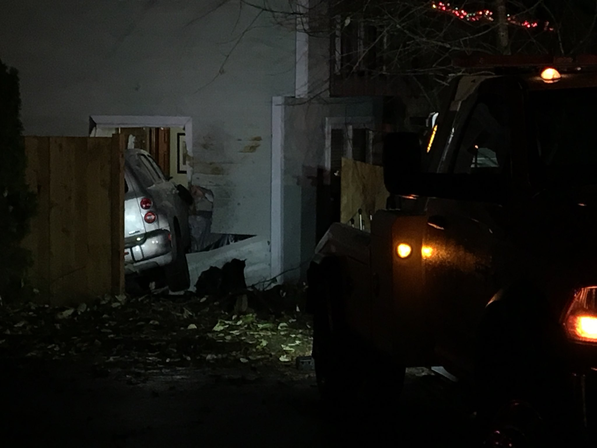 A car with two adults and a child crashed through a wall of a home in Federal Way overnight, injuring a woman in the bed on the other side. (Photo credit: Josh Morgan)<p></p>