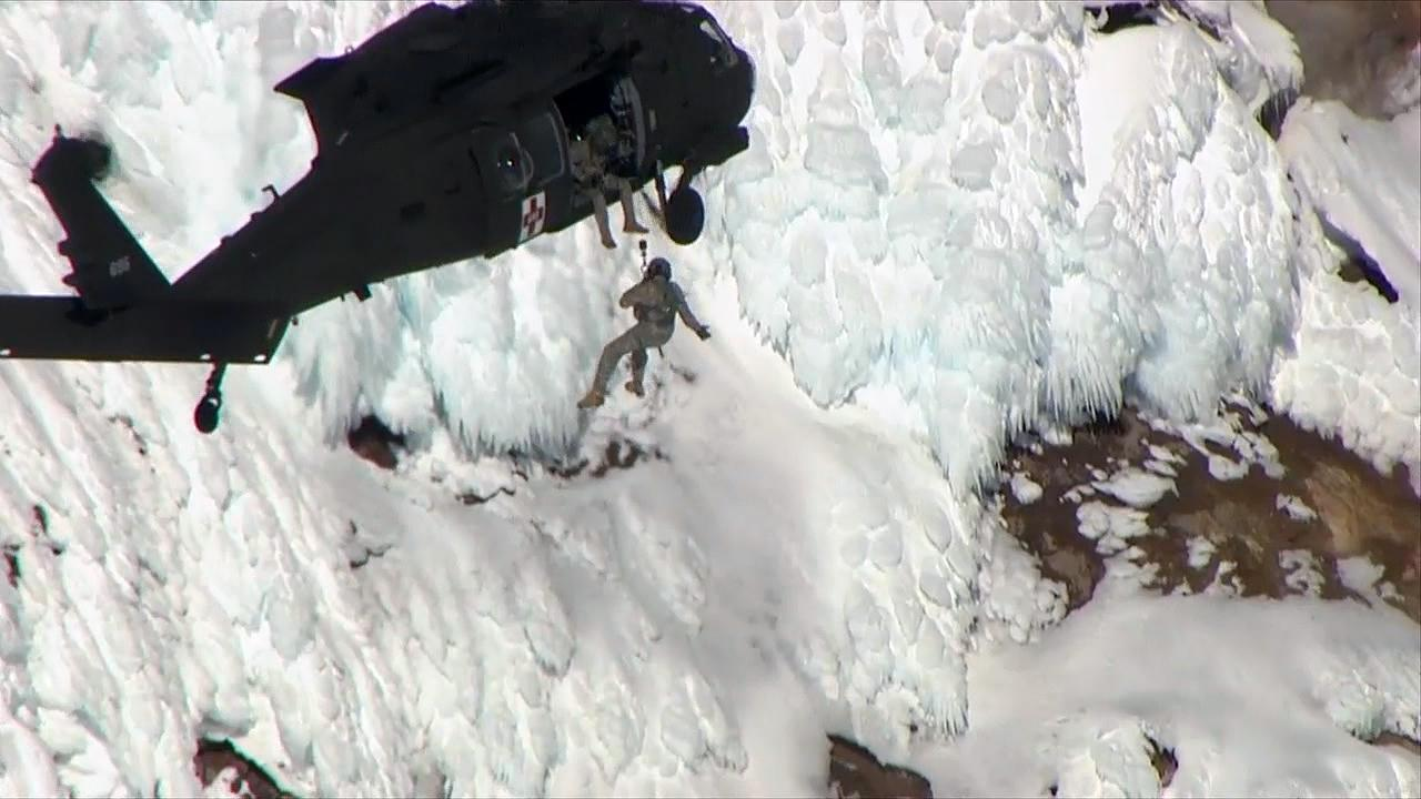 A rescuer is lowered down to a climber who fell on Mount Hood on Tuesday, Feb. 13, 2018. The climber was flown to Legacy Emanuel Medical Center in Portland where he was pronounced dead. (Photo: KATU/Chopper 2)