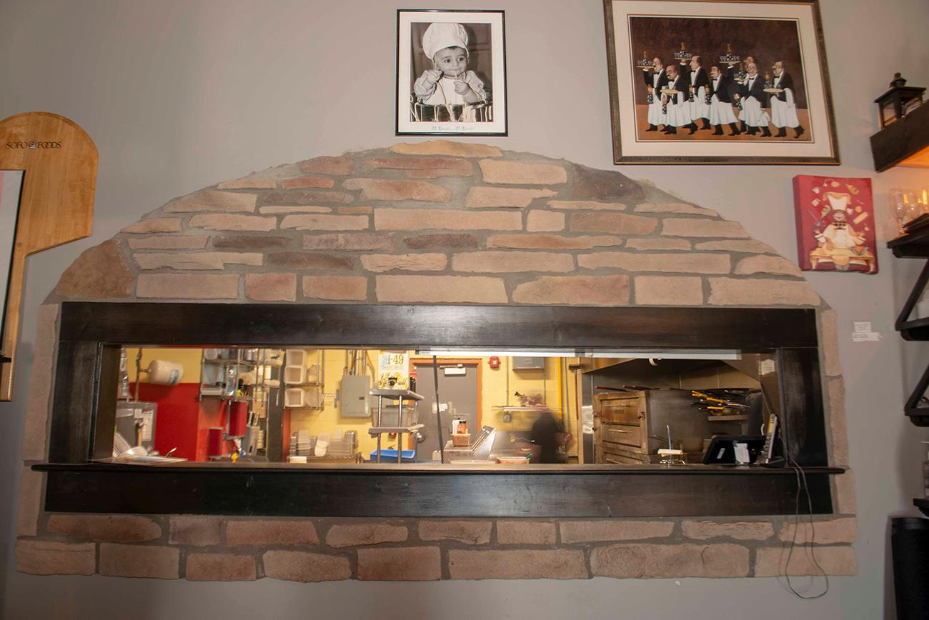 The walls in the restaurant pay tribute to the owner's ancestors, the Bonavita and Vilardo families, who came from a small town in Italy called Fuscaldo. They influenced the heritage and flavors that Chef Frommeyer still incorporates into the restaurant. / Image: Joe Simon //Published: 3.10.19<p></p>
