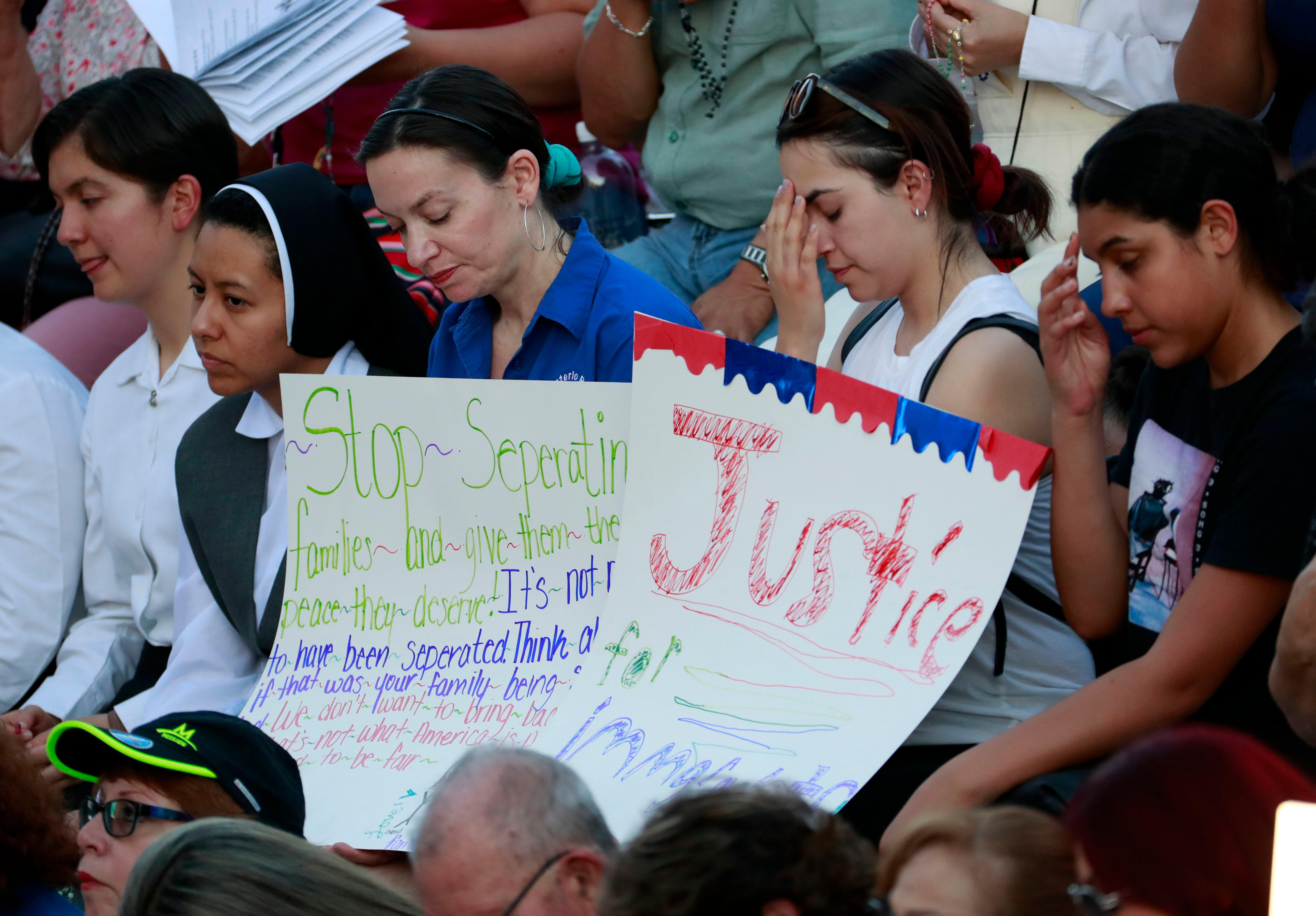People gather at Saint Mark Catholic Church for a solidarity with migrants vigil, Thursday, June 21, 2018 in El Paso, Texas. (AP Photo/Matt York)