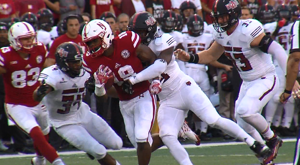 Tre Bryant gets wrapped up by an Arkansas State defender in the 1st half of the Huskers 43-35 win. (KHGI){&amp;nbsp;}<p></p>