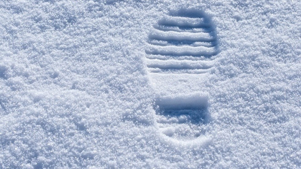 fleeing suspect captured after leaving trail of footprints in snow