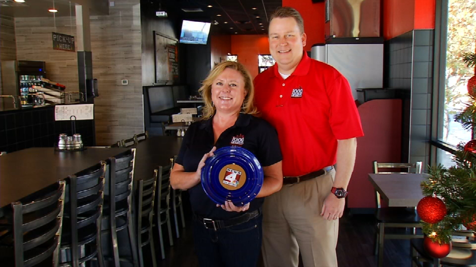 Ashley and Eric Andres, restaurant owners, holding their Blue Plate Award (News 4 San Antonio)<p></p>