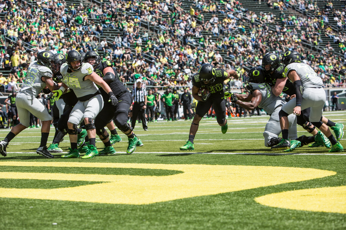 Team Brave running back Tony Brooks-James (#20) crosses the goal line for a touchdown. The 2017 Oregon Ducks Spring Game provided fans their first look at the team under new Head Coach Willie Taggart's direction.  Team Free defeated Team Brave 34-11 on a sunny day at Autzen Stadium in Eugene, Oregon.  Photo by Austin Hicks, Oregon News Lab