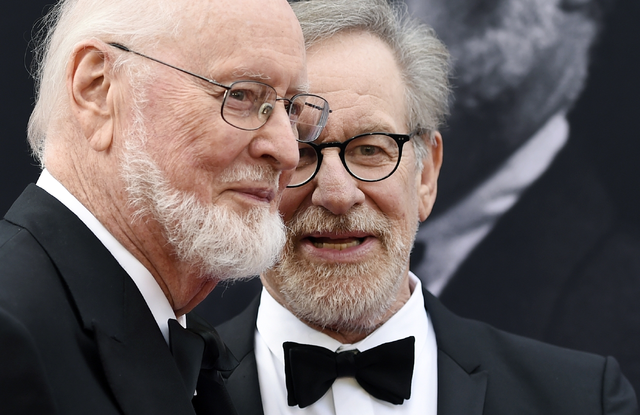 Composer John Williams, left, mingles with filmmaker Steven Spielberg on the red carpet at the 2016 AFI Life Achievement Award Gala Tribute to Williams at the Dolby Theatre on Thursday, June 9, 2016, in Los Angeles. (Photo by Chris Pizzello/Invision/AP)