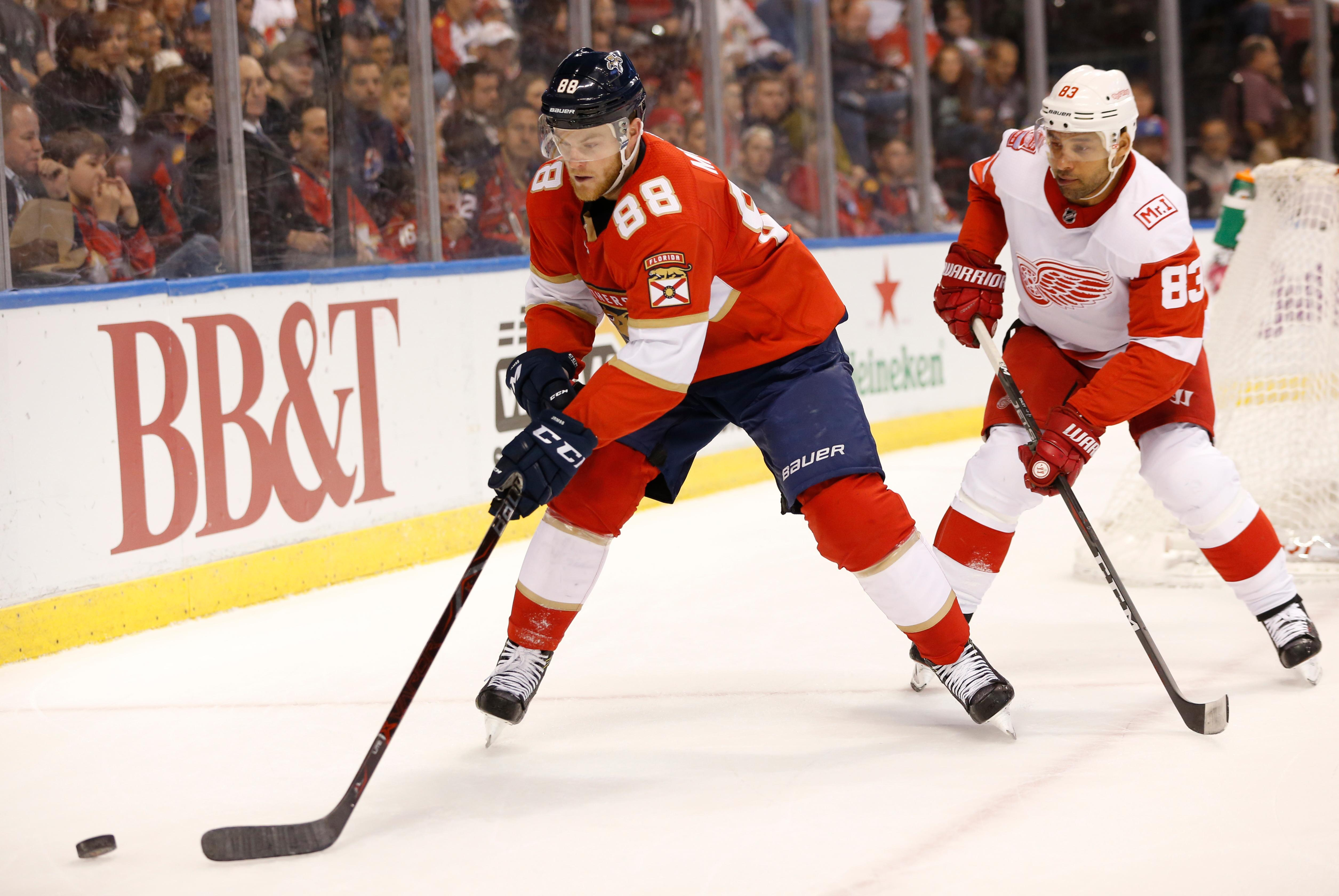 Florida Panthers left wing Jamie McGinn (88) and Detroit Red Wings defenseman Trevor Daley (83) battle for the puck during the first period of an NHL hockey game, Saturday, Feb. 3, 2018 in Sunrise, Fla. (AP Photo/Wilfredo Lee)